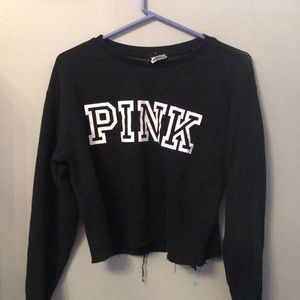I am selling a pink cropped sweatshirt.